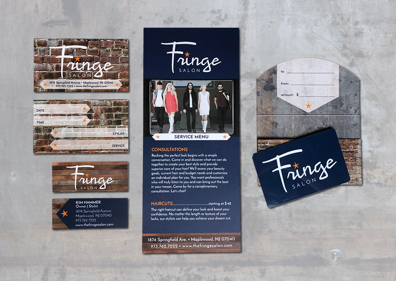 Fringe Salon Identity Suite | Clockwise from top left, an appointment card, front and back, with brick textured background and white lettering, a tall and narrow salon services menu that is navy blue with wood texture accents and a model photo, a gift card and enclosure (gift card is navy blue with white and orange logo, enclosure has brick texture on outside and rusted metal texture on inside), and a mini business card front and back (wood texture on front, navy blue with wood accent on reverse)