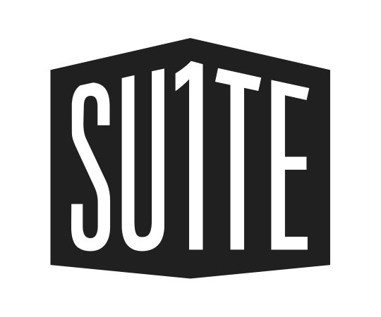 Suite 1 Logo | A black polygon on white ground with white letters that say SU1TE in a sans-serif font.