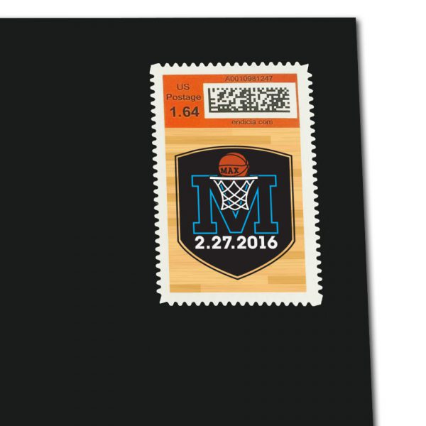 White vertical rectangular stamp on a black envelope. Stamp has black M logo on wood basketball court pattern, with orange band above showing postage rate and QR code.